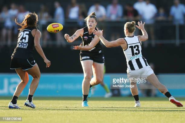 Brianna Davey of the Blues handballs during the round five AFLW match between the Carlton Blues and the Collingwood Magpies at Ikon Park on March 02...