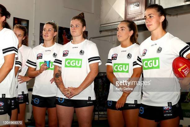 Brianna Davey of the Magpies and Aishling Sheridan of the Magpies look on during the guernsey presentation during the round one AFLW match between...