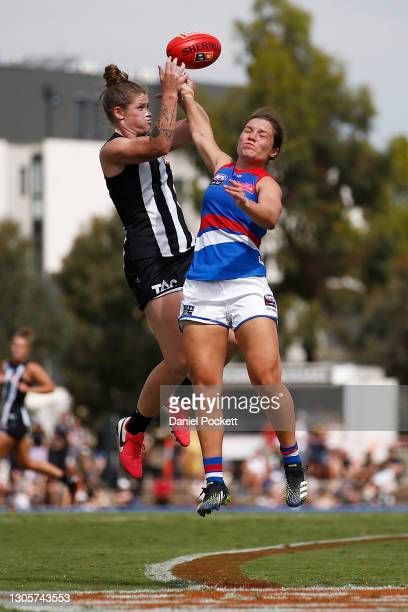 Brianna Davey of the Magpies and Ellie Blackburn of the Bulldogs contest the ball during the round six AFLW match between the Collingwood Magpies and...