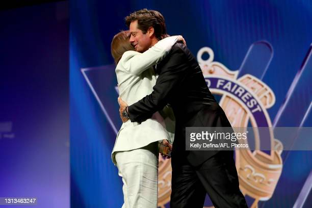 Brianna Davey of the Magpies celebrates winning the Best and Fairest award with Gillon McLachlan, Chief Executive Officer of the AFL during the 2021...