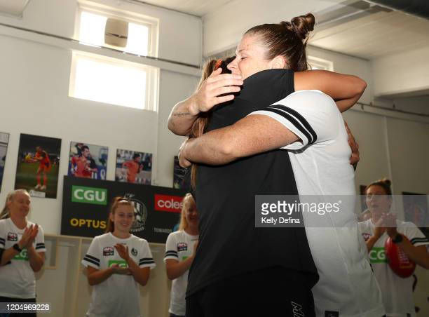 Brianna Davey of the Magpies is presented with her guernsey during the round one AFLW match between the Collingwood Magpies and the West Coast Eagles...