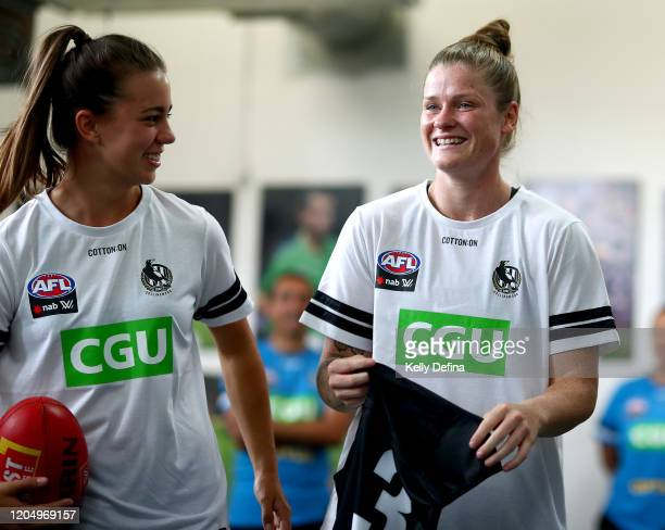 Brianna Davey of the Magpies reacts after being presented with her guernsey during the round one AFLW match between the Collingwood Magpies and the...