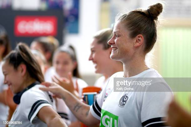 Brianna Davey of the Magpies reacts in the guernsey presentation during the round one AFLW match between the Collingwood Magpies and the West Coast...