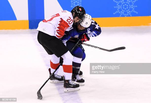 Brianna Decker of the United States fights for the puck with Sarah Nurse of Canada in the second period during the Women's Gold Medal Game on day...