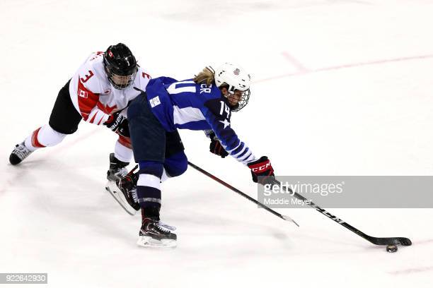 Brianna Decker of the United States skates against Jocelyne Larocque of Canada in the third period during the Women's Gold Medal Game on day thirteen...