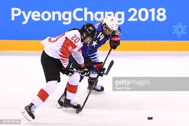 Brianna Decker of the United States skates against Sarah Nurse of Canada in the second period during the Women's Gold Medal Game on day thirteen of...