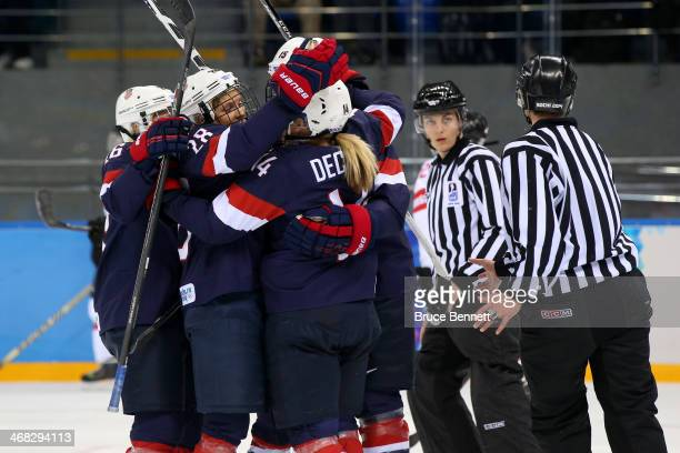 Brianna Decker of United States celebrates with teammates after scoring her team's second goal in the first period during the Women's Ice Hockey...