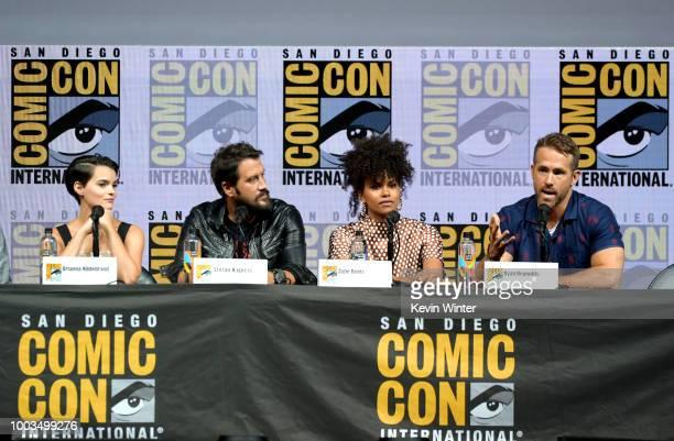 "Brianna Hildebrand, Stefan Kapicic, ;Zazie Beetz, and Ryan Reynolds speak onstage at the ""Deadpool 2"" panel during Comic-Con International 2018 at..."