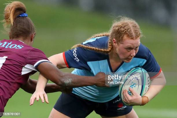 Brianna Hoy of the Waratahs runs with the ball during the Super W Final match between the NSW Waratahs and the Queensland Reds at Coffs Harbour...