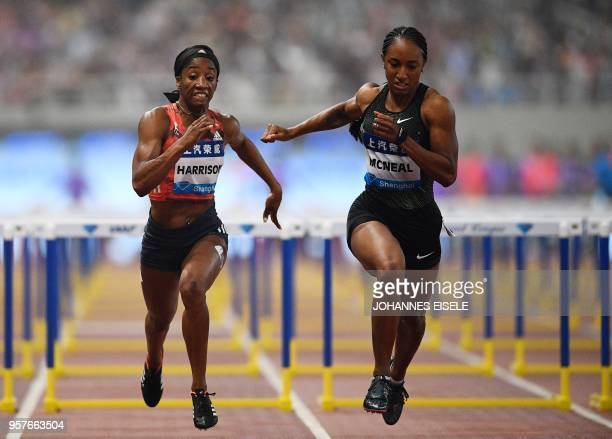 Brianna McNeal of the United States competes to win next to Kendra Harrison of the United States in the women's 100m hurdle event of the IAAF Diamond...