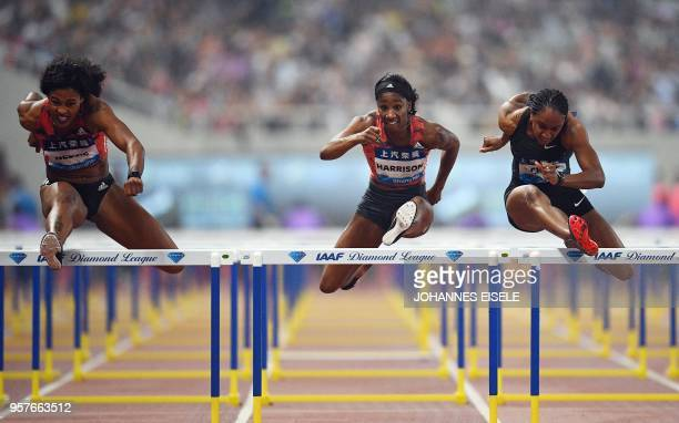 Brianna McNeal of the United States competes to win next to Kendra Harrison and Sharika Nelvis both of the United States in the women's 100m hurdle...