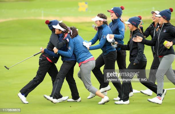Brianna Navarrosa of Team USA is embraced by Team USA players after she wins her match during the PING Junior Solheim Cup during Preview Day 3 of The...