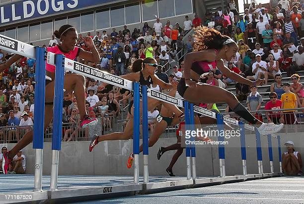 Brianna Rollins clears a hurrdle en route to winning the Women's 100 Meter Hurdles final on day three of the 2013 USA Outdoor Track Field...