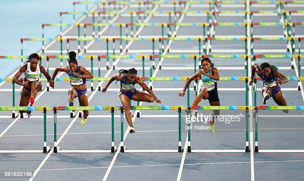 Brianna Rollins of the United States competes on her way to winning the gold medal in the Women's 100m Hurdles Final ahead of silver medalist Nia Ali...