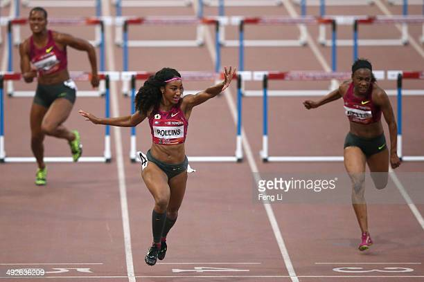 Brianna Rollins of the United States crosses the finishing line as her teammate Kellie Wells and Virginia Crawford followed during the Women's 100m...