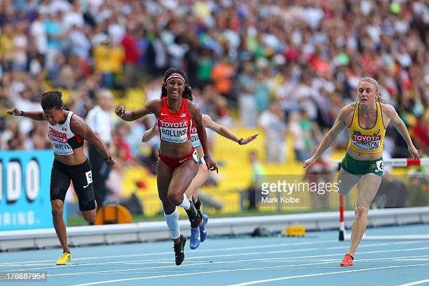 Brianna Rollins of the United States crosses the line to win gold ahead of Sally Pearson of Australia in the Women's 100 metres hurdles final during...