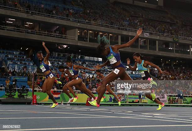 Brianna Rollins of the United States leads the pack as she crosses the finish line to win the gold medal in the Women's 100 metres hurdles final on...
