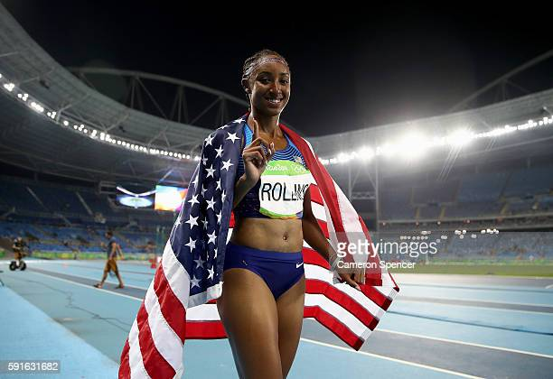 Brianna Rollins of the United States poses with the American flag after winning the gold medal in the Women's 100m Hurdles Final on Day 12 of the Rio...