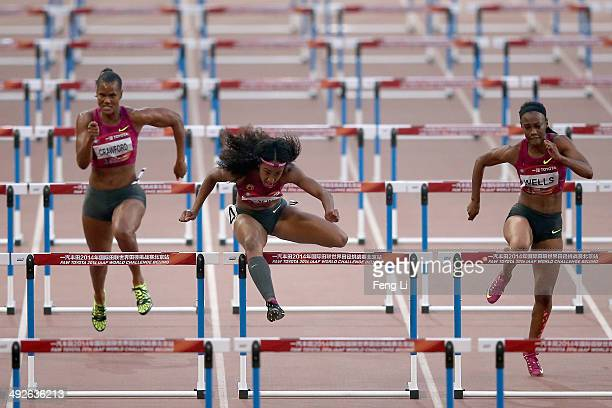 Brianna Rollins of the United States races as her teammate Kellie Wells and Virginia Crawford followed during the Women's 100m hurdles of 2014 IAAF...