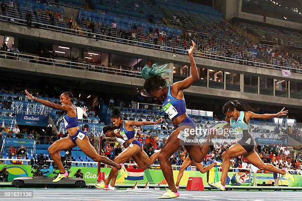 Brianna Rollins of the United States wins the gold medal in the Women's 100m Hurdles Final ahead of silver medalist Nia Ali of the United States and...