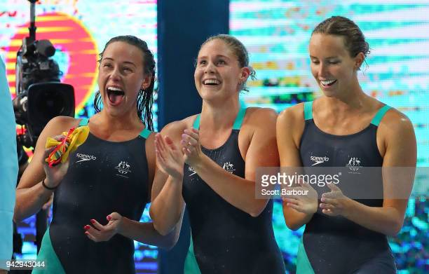 Brianna Throssell Leah Neale and Emma McKeon of Australia cheer on teammate Ariarne Titmus during the Women's 4 x 200m Freestyle Relay Final on day...