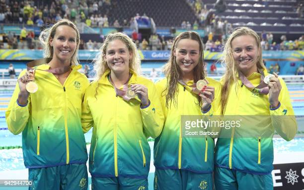 Brianna Throssell Leah Neale Ariarne Titmus and Emma McKeon of Australia celebrate with their gold medals after winning the Women's 4 x 200m...