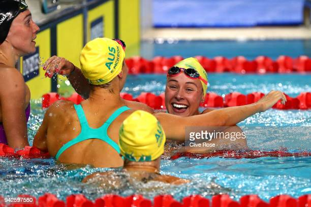 Brianna Throssell of Australia celebrates with teammates Madeline Groves and Emma Mckeon following the Women's 100m Butterfly Final on day two of the...