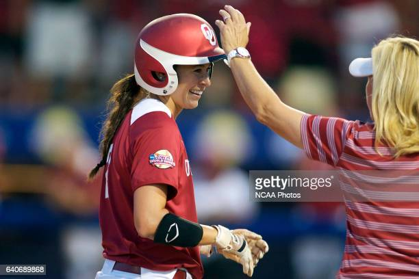 Brianna Turang of the University of Oklahoma celebrates a single against the University of Alabama during the Division I Women's Softball...