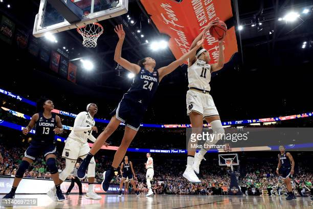 Brianna Turner of the Notre Dame Fighting Irish grabs the rebound from Napheesa Collier of the UConn Huskies during the fourth quarter in the...