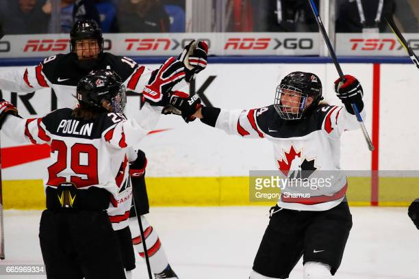 Brianne Jenner of Canada celebrates her third period goal with MariePhilip Poulin and Natalie Spooner while playing the the United States in the gold...