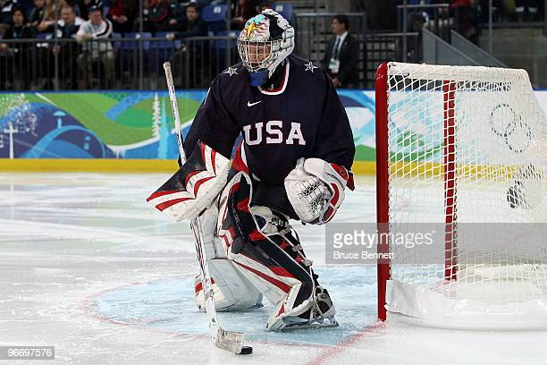 Brianne Mclaughlin of the United States handles the puck against China during their women's ice hockey preliminary game at UBC Thunderbird Arena on...