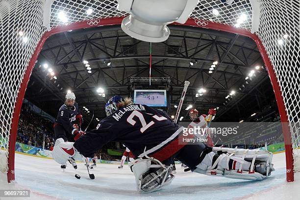 Brianne Mclaughlin of the United States makes a save against China during their women's ice hockey preliminary game at UBC Thunderbird Arena on...