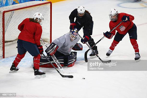 Brianne McLaughlin of the United States women's ice hockey team attempts to make a save during a training session ahead of the Sochi 2014 Winter...