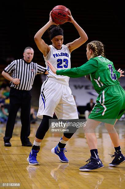 Brianne Stiers of Highlands Ranch looks for a passing lane around Madison Ward of ThunderRidge during the third quarter at the Coors Events Center on...