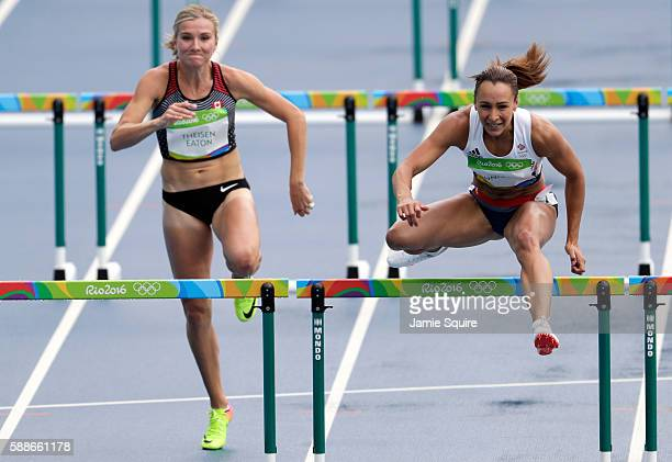 Brianne Theisen Eaton of Canada and Jessica EnnisHill of Great Britain compete in the Women's Heptathlon 100 Meter Hurdles on Day 7 of the Rio 2016...