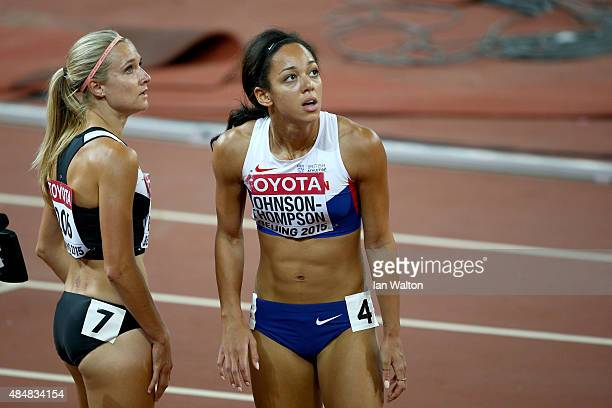 Brianne Theisen Eaton of Canada and Katarina Johnson-Thompson of Great Britain look on after competing in the Women's Heptathlon 200 metres during...