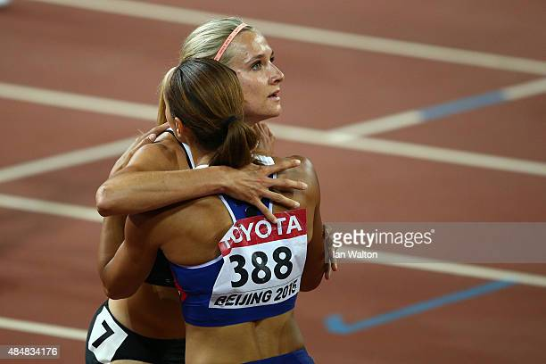 Brianne Theisen Eaton of Canada embraces Jessica Ennis-Hill of Great Britain after competing in the Women's Heptathlon 200 metres during day one of...
