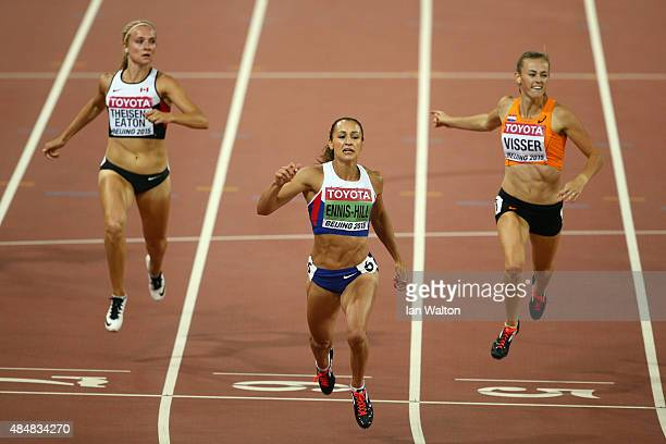 Brianne Theisen Eaton of Canada, Jessica Ennis-Hill of Great Britain and Nadine Visser of the Netherlands cross the finish line in the Women's...