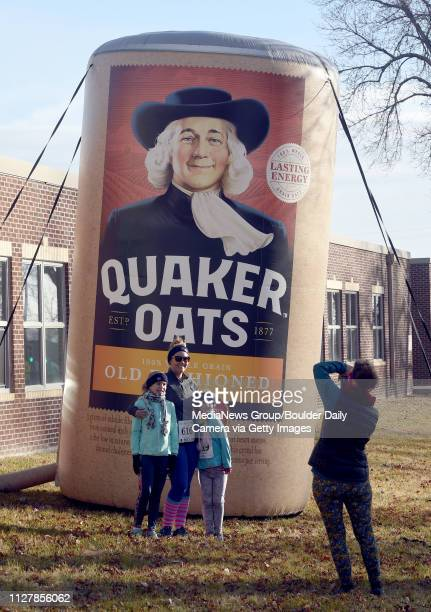 Brianne Warren, and her daughters, Jaylynn and Sienna are photographed by their grandmother, Deb Ford, in front of the Quaker Oats blow up container....