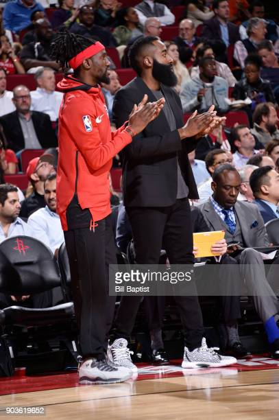 Briante Weber and James Harden of the Houston Rockets react to a play from courtside against the Portland Trail Blazers on January 10 2018 at the...