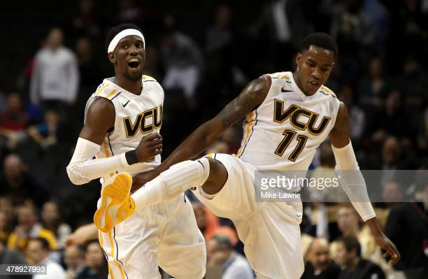 Briante Weber and Rob Brandenberg of the Virginia Commonwealth Rams celebrate after a basket by Brandenberg to end the first half against the George...