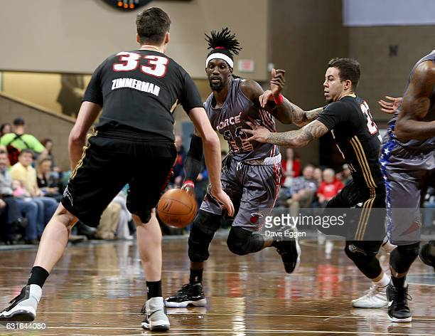 Briante Weber from the Sioux Falls Skyforce handles the ball between defenders including Gabe York from the Erie Bayhawks at the Sanford Pentagon...