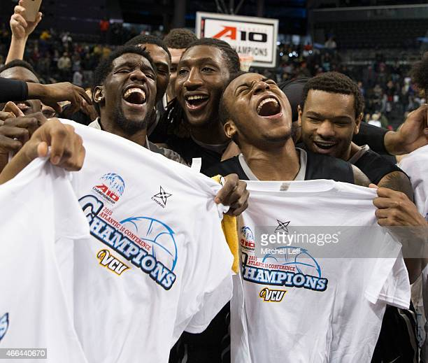 Briante Weber Mo AlieCox Melvin Johnson and Jordan Burgess of the Virginia Commonwealth Rams celebrate their win against the Dayton Flyers in the...