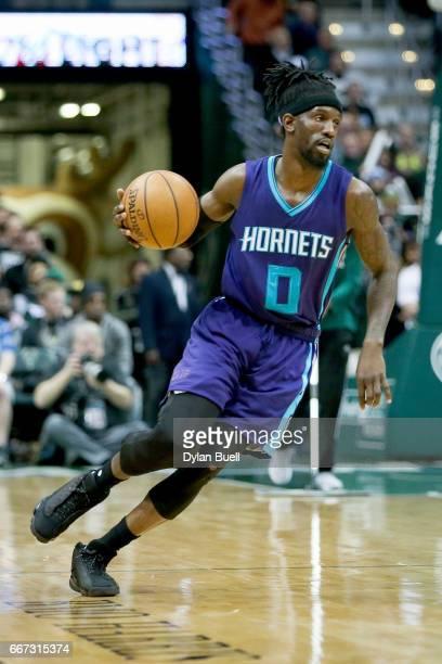 Briante Weber of the Charlotte Hornets dribbles the ball in the fourth quarter against the Milwaukee Bucks at BMO Harris Bradley Center on April 10...
