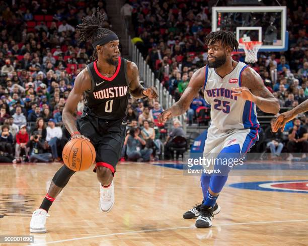Briante Weber of the Houston Rockets moves the ball up court against Reggie Bullock of the Detroit Pistons during the an NBA game at Little Caesars...