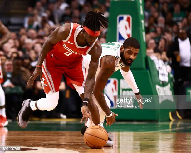 Briante Weber of the Houston Rockets steals the ball from Kyrie Irving of the Boston Celtics during the first quarter of the game at TD Garden on...