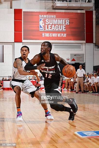 Briante Weber of the Miami Heat drives to the basket against Tyler Ulis of the Phoenix Suns during the 2016 NBA Las Vegas Summer League game on July...