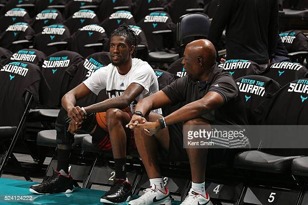 Briante Weber of the Miami Heat talks to the coaching staff before Game Three of the Eastern Conference Quarterfinals against the Charlotte Hornets...
