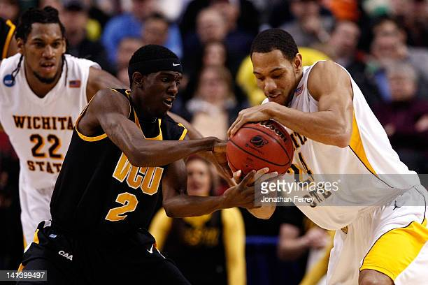Briante Weber of the Virginia Commonwaealth Rams and David Kyles of the Wichita State Shockers battle for the ball in the second half in the second...
