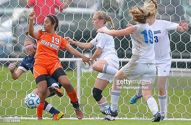 Briar Woods' goalie Tori Riopelle left and teammate Mia Venkat 2nd left block theball on a Blacksburg corner kick as Briar Woods defeats Blacksburg 1...